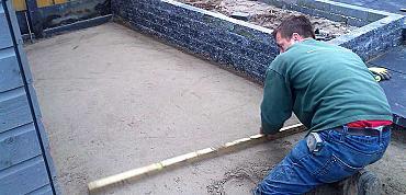 Hoe maak je een goed zandbed?